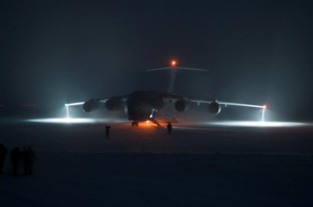 Airplane on ice at night.
