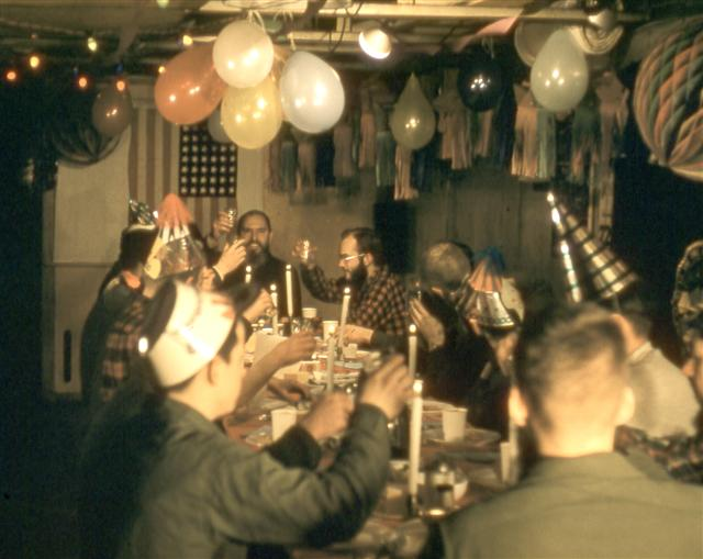 Men having a party with balloons.