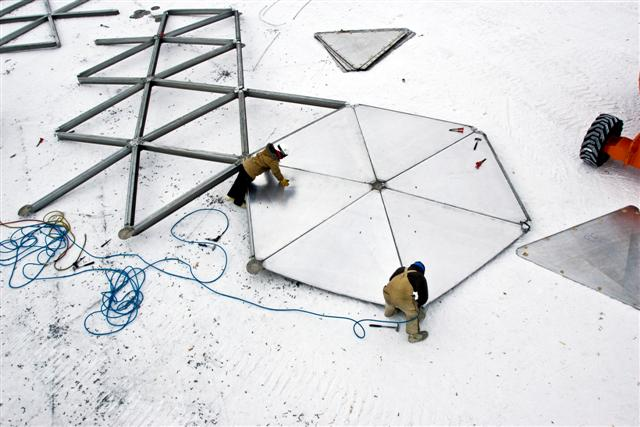 Crew disassembles dome panels.