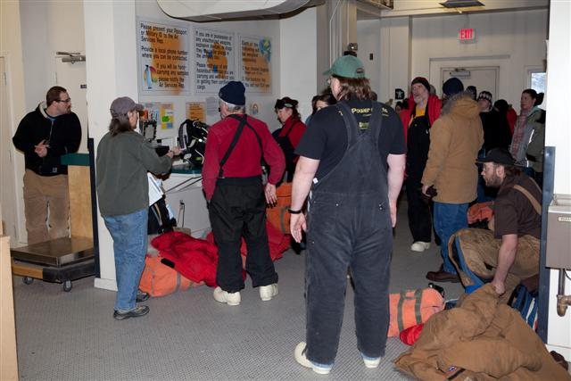Passengers prepare to depart McMurdo Station.