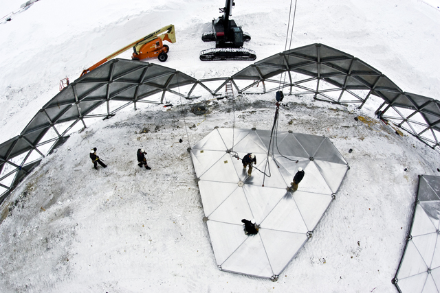A crew disassembles the South Pole Dome.