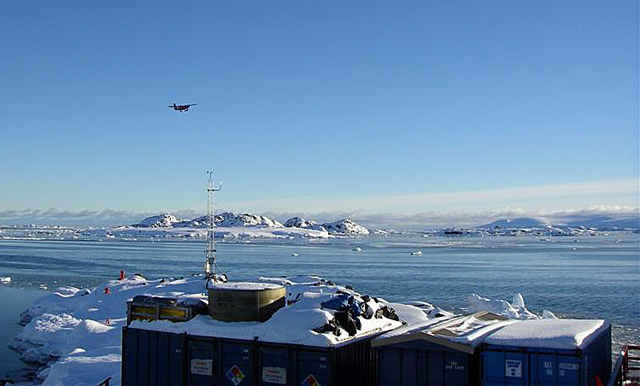 Chilean plane flies by Palmer Station.