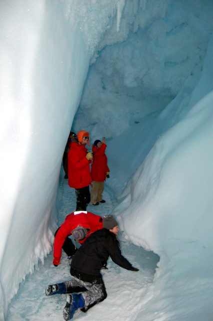 McMurdo residents explore an ice cave.