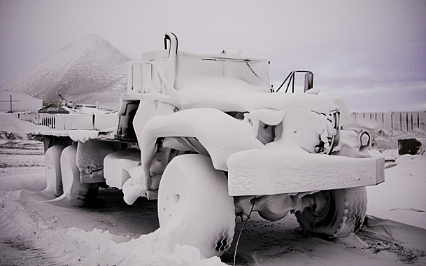 Truck covered in snow at McMurdo Station.