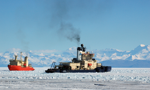 Two ships move through sea ice.