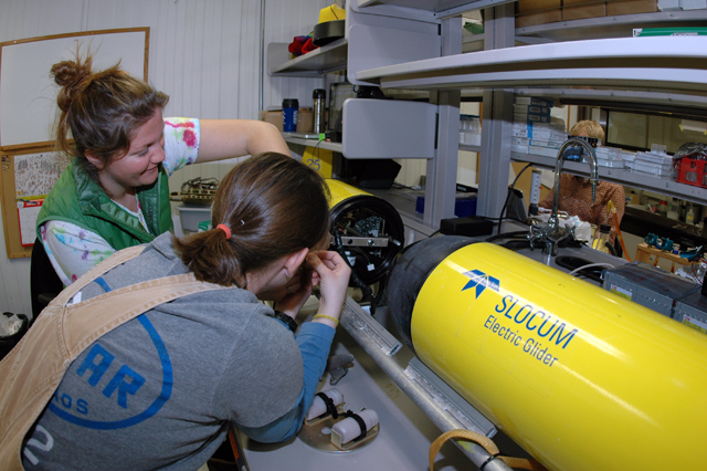 Scientists work on underwater glider.
