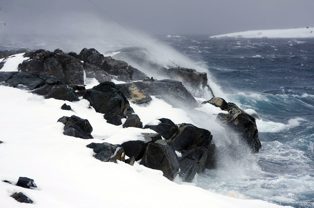 Waves crash on rocks near Palmer Station.