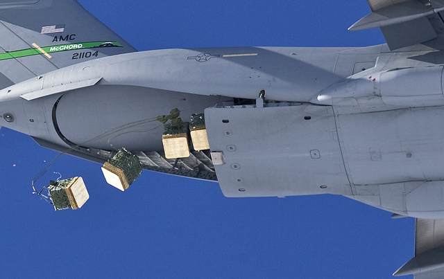 An Air Force C-17 drops cargo over South Pole.