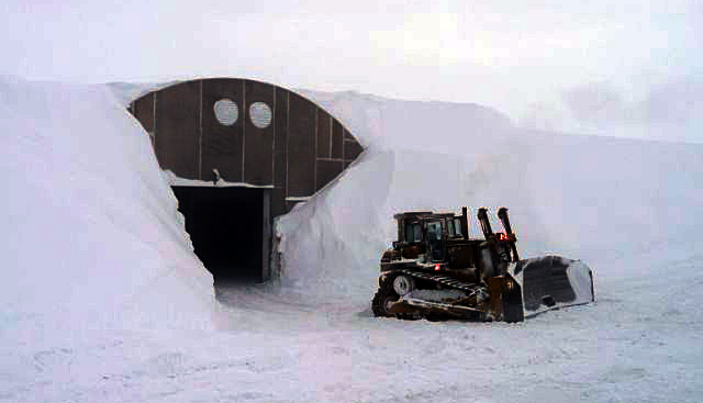 Snow piled high around the garage arch at South Pole.