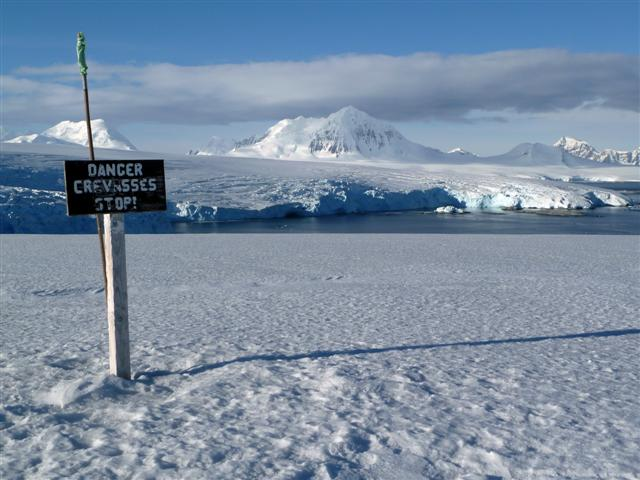 Signs warns of crevasse danger.