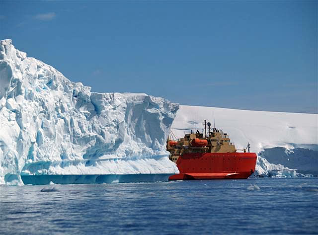 Ship navigates through icebergs.