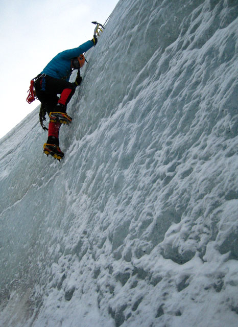 Person climbs an ice wall.