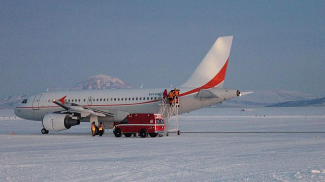Airplane sits on ice.