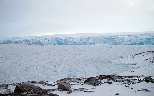 Ice-covered seas and distant glacier.