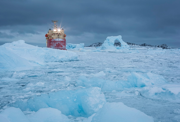 The research vessel LAURENCE M. GOULD camps out just outside the dense iceberg obstacle course inside Hero Inlet.