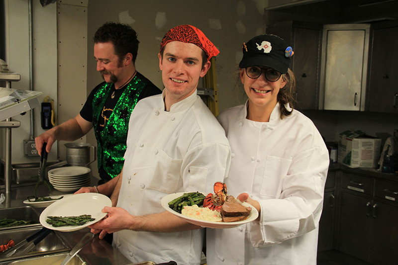 Chefs Lisa Minelli-Endlich and Zack Morgan prepare to serve Midwinter dinner
