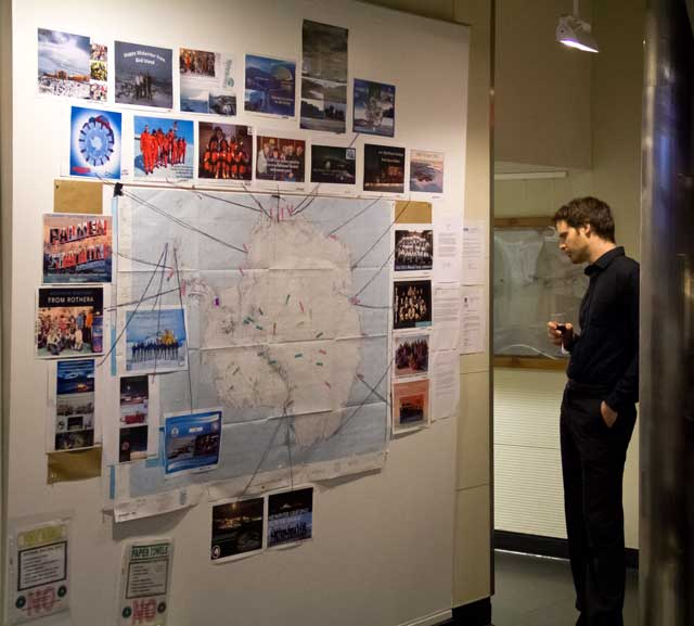 Person looks at map and photos.