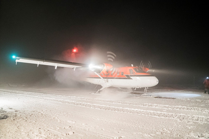 After landing, the medevac Twin Otter pulls forward onto bamboo mats to prevent the skis from freezing to the snow