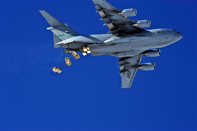 C-17 dropping cargo.