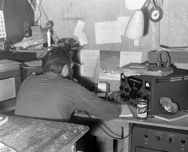 Cliff Dickey works a ham radio at South Pole