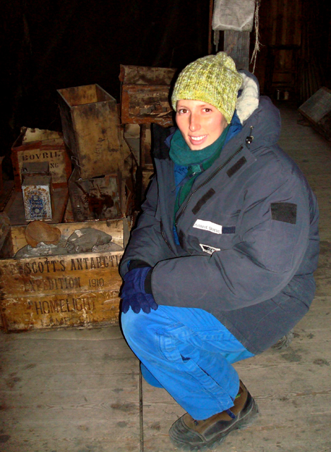 Susanne Grieve inspects artifacts in Discovery Hut.
