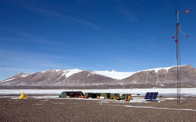 Fryxell Field Camp with wind and solar array.