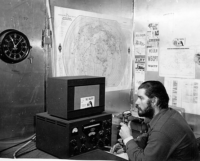 Man operates ham radio in 1956.