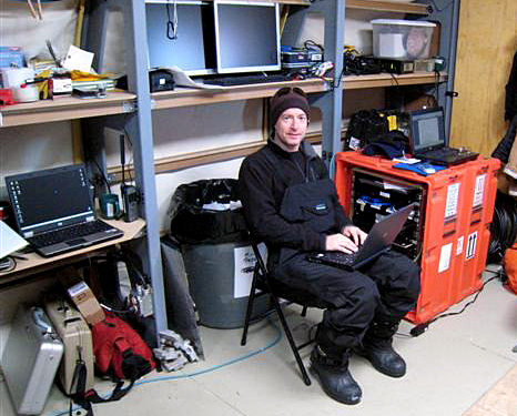 IT employee next to portable IMCS.