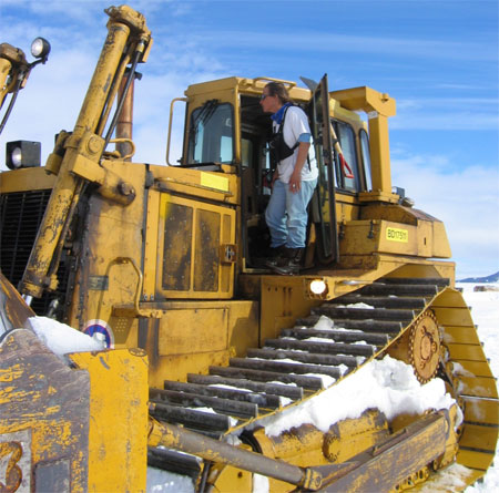 Woman on heavy machine.