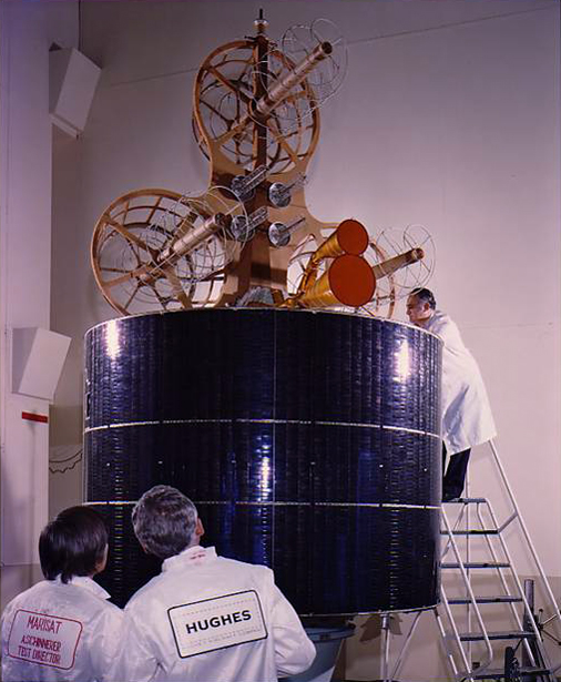 Engineers work on a Marisat satellite.