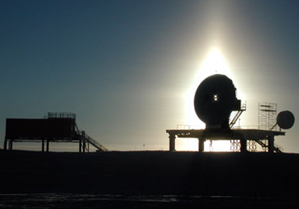 A silhouette of the South Pole Marisat-GOES Terminal.