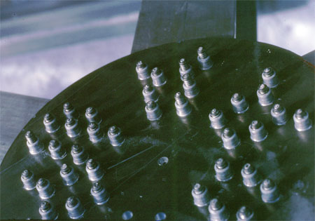 Gusset Plate showing installed Huck bolts.