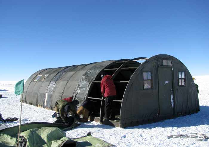 Workers erect a polar haven at AGAP South camp.