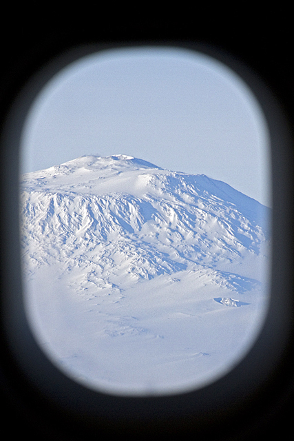 Picture of snow-covered mountain out of window.