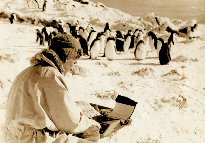 Geoffrey Lee Martin typing a story in Antarctica.