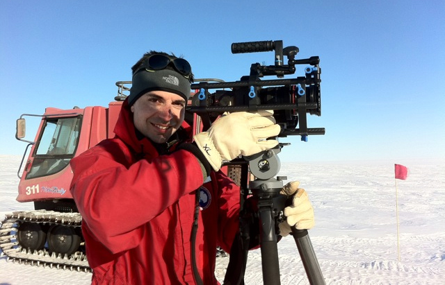 Man with camera in cold place.