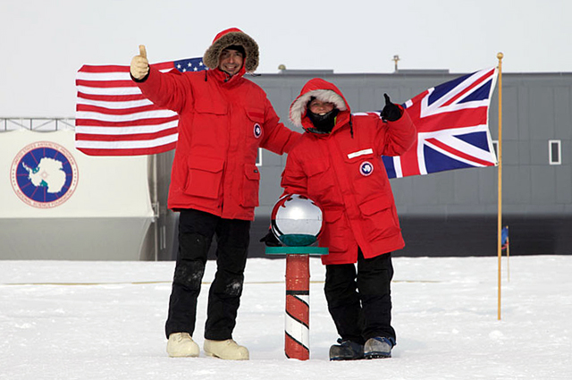 People give thumbs up at South Pole.