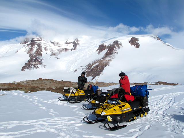 People on snowmobiles.