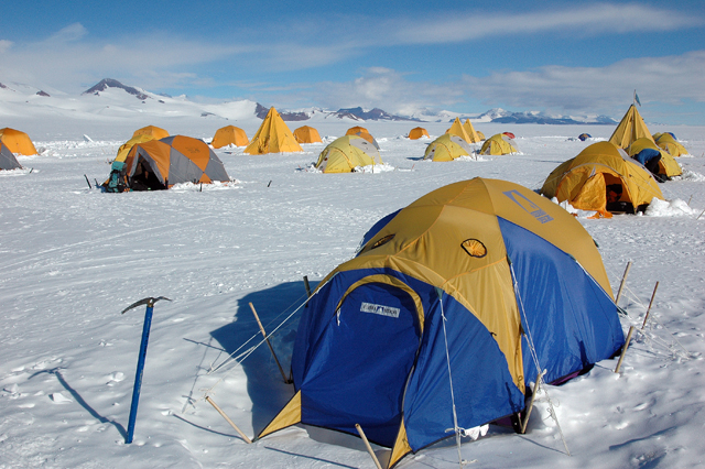 Tents pitched on snow.