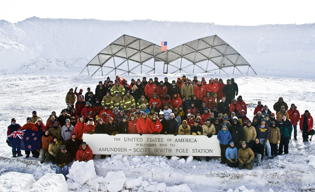 The whole South Pole Station crew poses in front of the last panel.