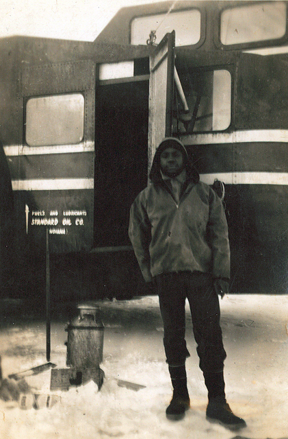 Man stands in front of vehicle.