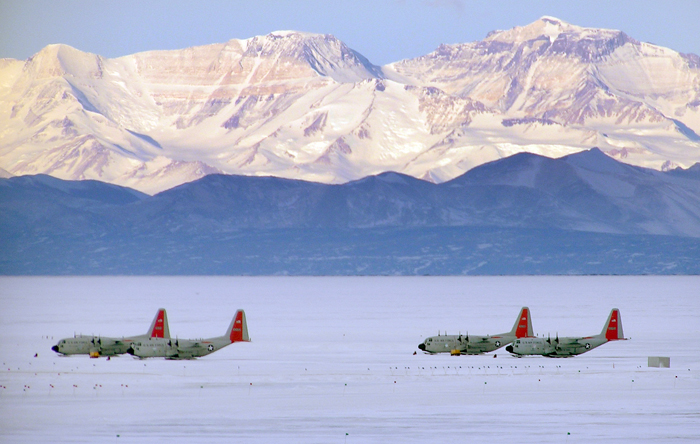 NYANG LC-130s sit on the sea ice runway.