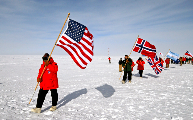 Jerry Marty takes part of South Pole flag ceremony.