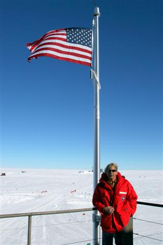 Jerry Marty stands at the flagpole of the new South Pole Station.