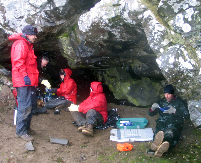 Livingston Island party takes shelter in cave.