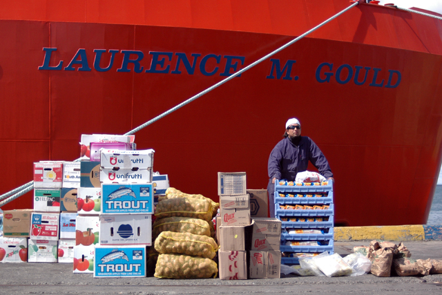 Dock worker waits to load food.