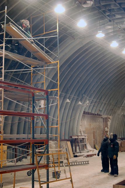 Crew installs lighting in logistics arch at South Pole.