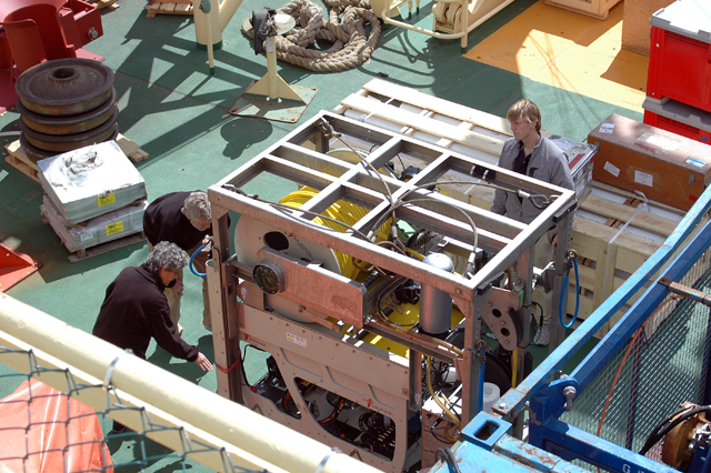 People examine cargo aboard the Palmer.