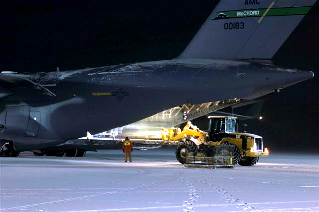 Offloading cargo from C17 at night.