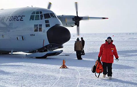 Person exits airplane on ice.